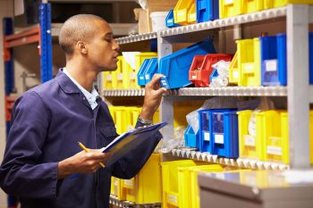 Man Using Manual Inventory Tracking Methods