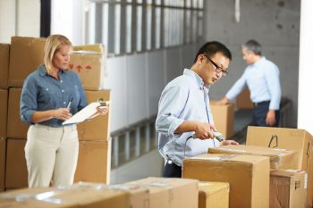 Employees Manually Tracking Inventory Together